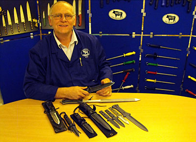 George Holden with selection of Todd Knives