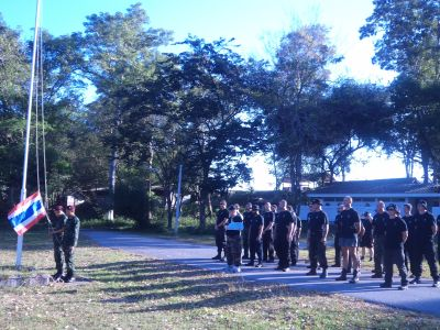 Instructors and exponents show their respect each morning on course with the raising of the flag.